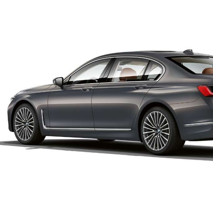 Grey BMW 7 Series Sedan with Exterior Design Pure Excellence in three-quarter rear view